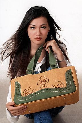 asian model holds handmade bag